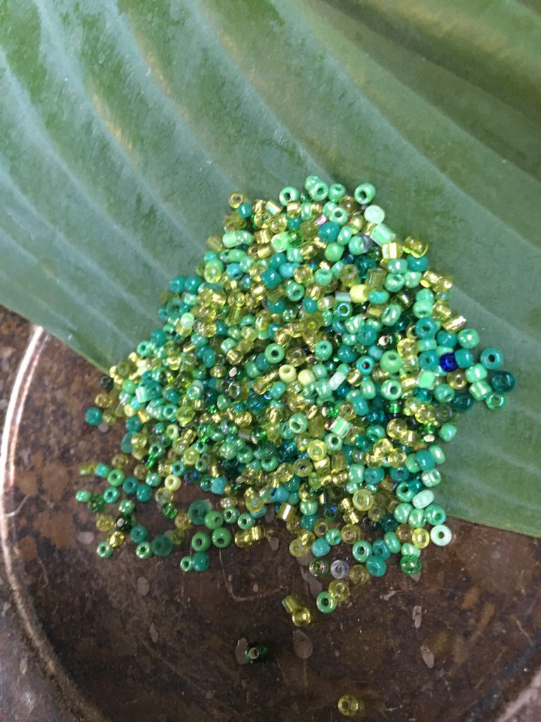 10 grams of secondhand-sourced small green glass seed beads