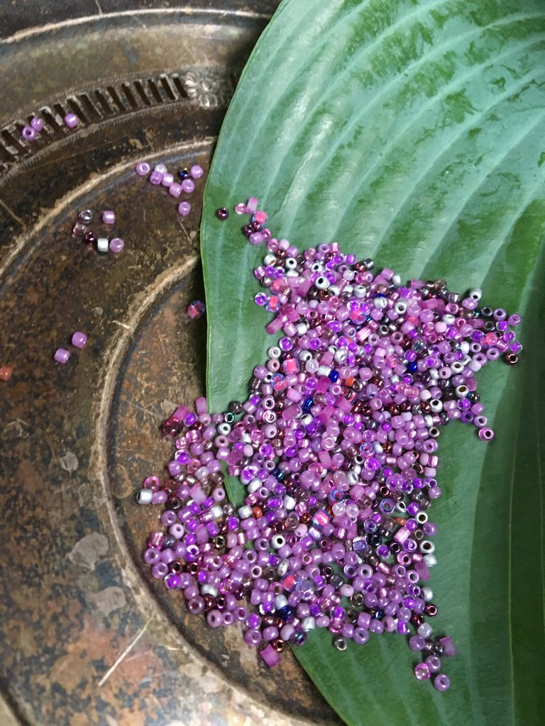 10 grams of secondhand-sourced small purple glass seed beads
