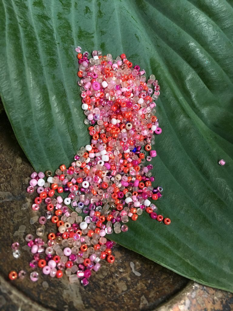 10 grams of secondhand-sourced small pink glass seed beads